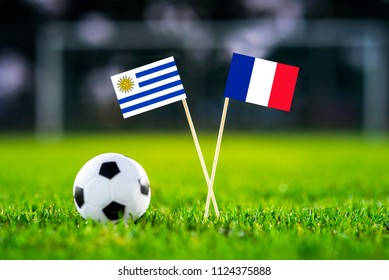 Uruguay and France national Flag on football stadium. Uruguay - France, Quarterfinal. 6. July, Football play-off