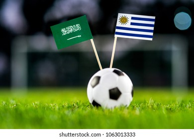 Uruguay - Saudi Arabia, Group A, Wednesday, 20. June, Football, World Cup, Russia 2018, National Flags on green grass, white football ball on ground.