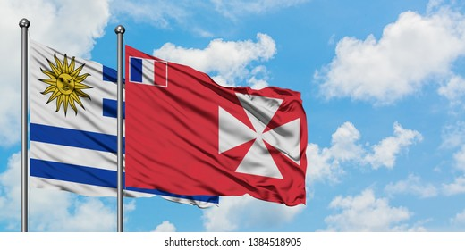 Uruguay and Wallis And Futuna flag waving in the wind against white cloudy blue sky together. Diplomacy concept, international relations.