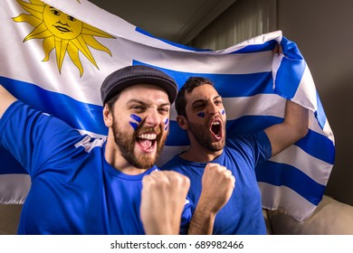 Uruguayan fans holding the national flag