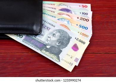 Uruguayan money in the black wallet
