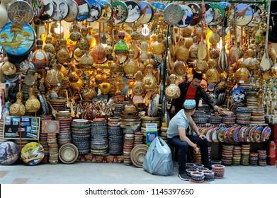 Urumqi,China - June 1, 2018: traditional musical instrument sellers are sorting their goods in the International Market in Urumqi, Xinjiang, China.