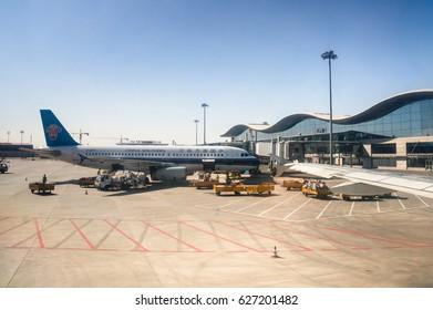 URUMQI,CHINA-APRIL19:A China Southern airlines's aircraft loading cargo before departure from Urumqi Diwopu International Airport on April 19,2017 in Urumqi, Xinjiang Uyghur Autonomous Region , China.
