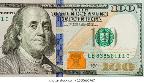 US 100 dollar bill close up, USA federal fed reserve note fragment. American dollar is the official currency of the United States of America