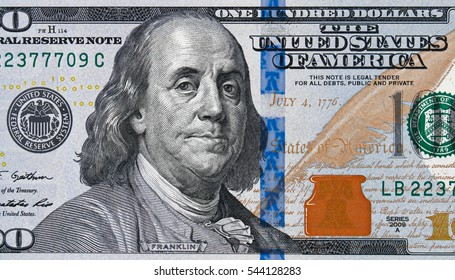 US 100 dollar bill close up, USA federal fed reserve note fragment. American dollar is the official currency of the United States of America.