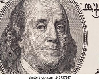 US 100 dollar bill fragment closeup, Benjamin Franklin face portrait, united states money