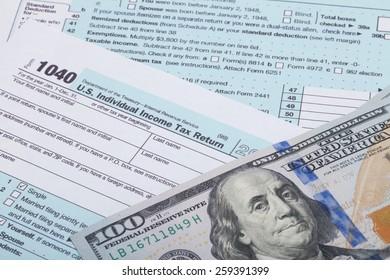 US 1040 Tax Form and dollars - studio shot