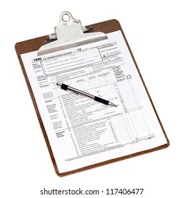 U.S. 2012 income tax form 1040 on a clipboard with a pen. Isolated on white with a clipping path.