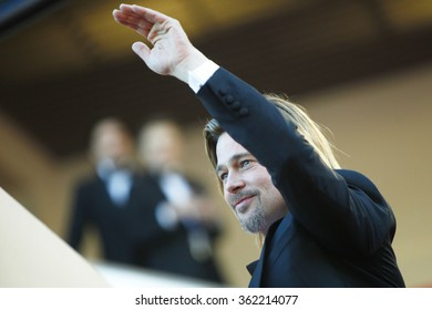 US actor Brad Pitt waves to the crowd as he arrives for the screening of 'Killing them Softly' presented in competition at the 65th Cannes film festival on May 22, 2012 in Cannes.