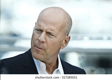 US actor Bruce Willis poses during the photocall of 'Moonrise Kingdom' at the 65th Cannes film festival on May 16, 2012 in Cannes