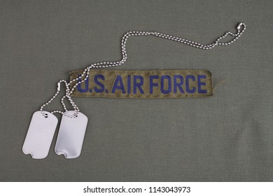 U.S. AIR FORCE Branch Tape with dog tags on olive green uniform background