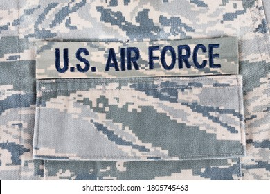 US AIR FORCE branch tape on digital tiger-stripe pattern Airman Battle Uniform (ABU) background
