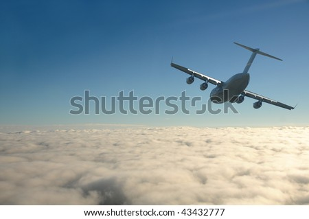 US Air Force cargo airplane above the clouds