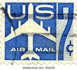 US Air Mail Stamp, seven cents from the 1970s showing a jet plane and a large number 7 seven.
