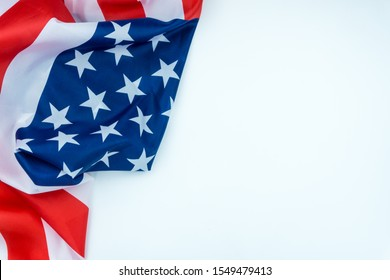 US American flag on white background. For USA Memorial day, Veterans day, Labor day, or 4th of July celebration. Top view, copy space for text.