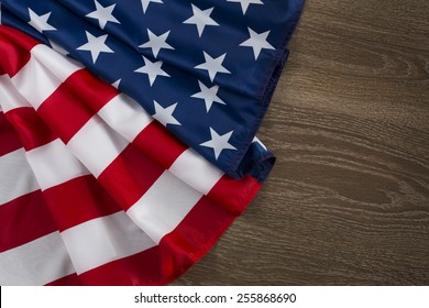 US, American flag on wood background