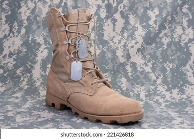 US ARMY concept  - camouflage background with desert boots