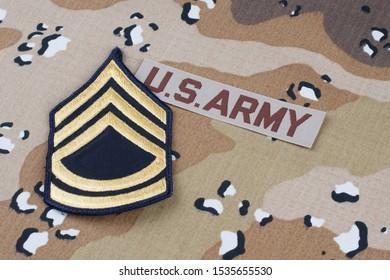 US ARMY desert pattern battle dress uniform with rank patch