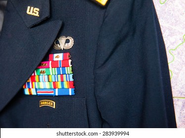 us army dress uniform in front of a map