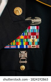US Army dress uniform with ribbons, medals, and badges.