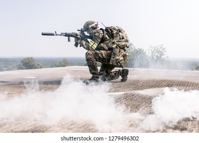 Us army Ranger during military operation with assault rifle prepare for assault