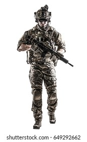US Army rangers in combat uniforms with his shirt sleeves rolled up, in helmet, eyewear and night vision goggles moving walking towards camera. Studio shot, white background, dark contrast
