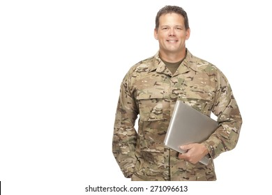 U.S. Army Soldier, Sergeant. Isolated and holding laptop with smile on face.