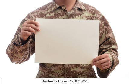 US Army. Young soldier holding a blank paper standing on white background