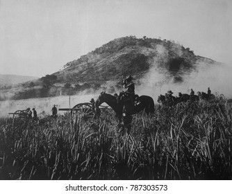 US artillery, shelling at Coamo, on August 9, 1898, while advancing into Puerto Rican interior. The American invaders opposition in inconclusive fighting during the Spanish American War