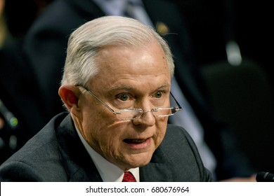 US. Attorney General Jeff Sessions reads his prepared opening statement after being sworn in to testify in front of the Senate Intelligence Committee. Washington DC, June 13, 2017.