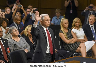 US. Attorney General Jeff Sessions raises his right as he prepares to be sworn in to testify in front of the Senate Intelligence Committee. Washington DC, June 13, 2017.