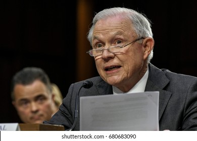 US. Attorney General Jeff Sessions reads from prepared answers in response to a question from one of the members of the Senate Intelligence Committee during his testimony Washington DC, June 13, 2017.