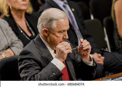 US. Attorney General Jeff Sessions removes his reading glasses after reading his opening statements at the start of his testimony at the Senate Intelligence  Committee. Washington DC, June 13, 2017.