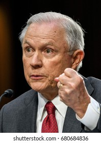 US. Attorney General Jeff Sessions raises his fist to make his point in response to a question from the members of the Senate Intelligence Committee during his testimony  Washington DC, June 13, 2017.