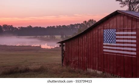 US Barn at Sunrise near pond in North Carolina