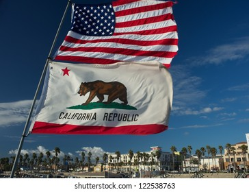 US and California state flag fluttering on huntington beach, California