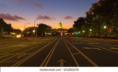 US Capitol building at dawn as seen from Pennsylvania Avenue. Colorful sunrise along Pennsylvania Avenue in Washington DC.