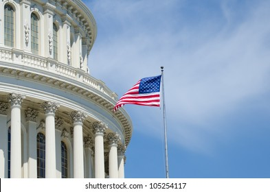 US Capitol Building dome detail with flapping US flag - Washington DC