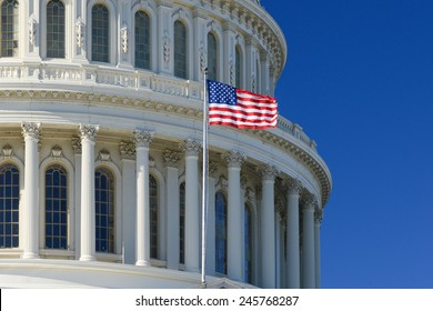 US Capitol Building dome detail with waving national flag - Washington DC, United States of America