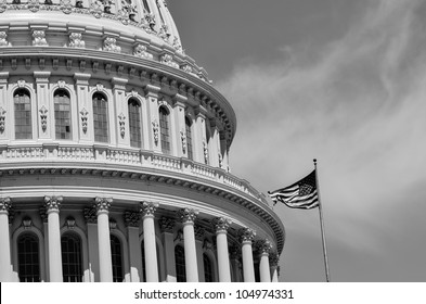 US Capitol Building east facade dome detail with flapping US flag in black and white - Washington DC