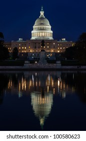 US Capitol Building in Washington DC at night with mirror reflection on pool