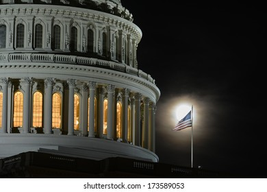 US Capitol dome detail with flapping US National Flag in full Moon light - Washington DC, USA