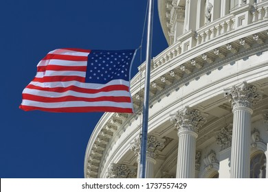 U.S. Capitol Dome  and waving US National flag close-up - Washington D.C. United States of America - Shutterstock ID 1737557429