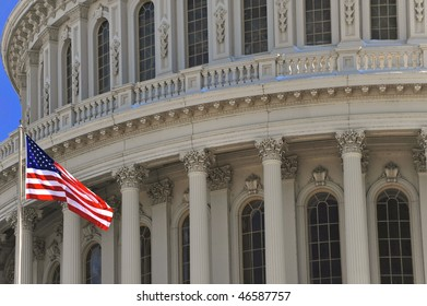 The US Capitol and US flag close up