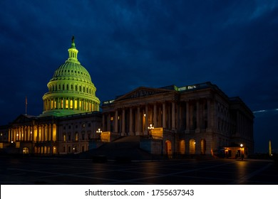 U.S. Capitol is one of many landmarks in Washington DC, USA. Its ambient lights make the building to look even better at night time.  - Shutterstock ID 1755637343