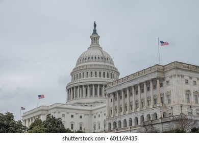 U.S. Capitol with Three Flags