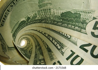 US Cash bills in a tornado shape; 1,2,5,10,20,50 dollar denominations; isolated white