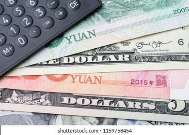 US and China finance currency exchange, trade war, import and export or world economy concept, black calculator on US dollar and china yuan banknotes, tariff deal for major countries.