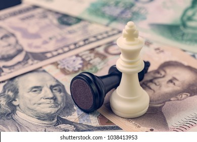 US and China finance trade war concept, black loser and white winner chess king on US dollar and china yuan banknotes, world major market countries.