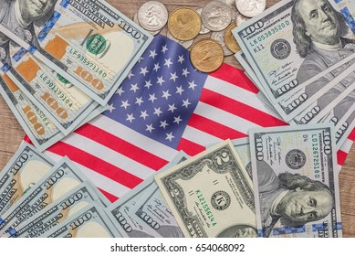 us coin and dollar banknote with usa flag